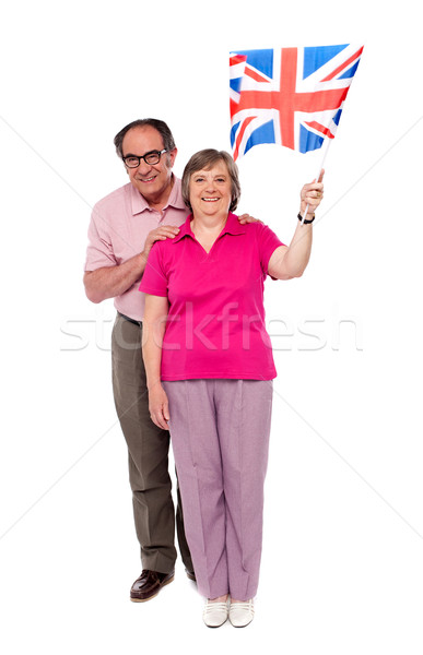 Old couple waving UK flag. Supporting nation Stock photo © stockyimages