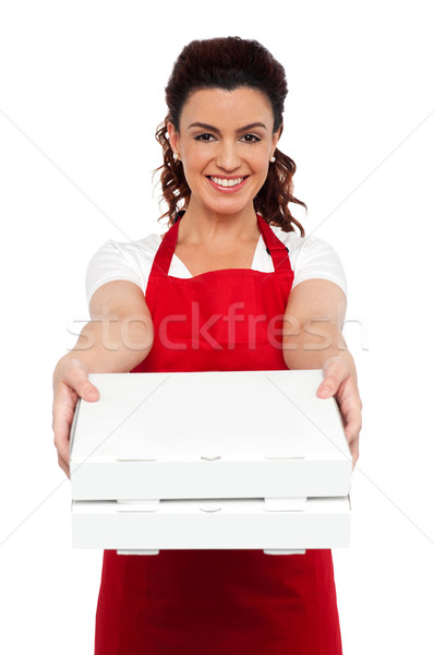 Here is your order sir. Hot pizza at your doorstep Stock photo © stockyimages