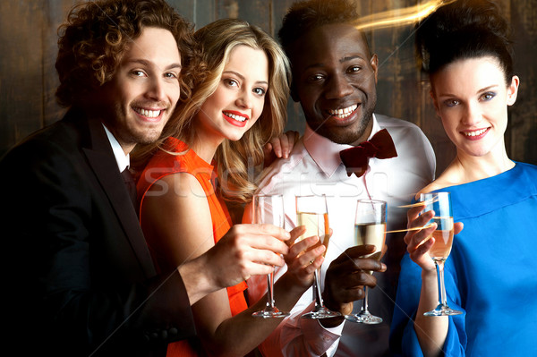 Group of friends at the bar, cheers to all... Stock photo © stockyimages