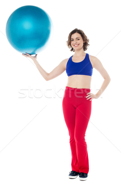 Lady gym instructor holding pilates ball Stock photo © stockyimages