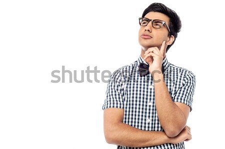 Thoughtful young man looking up Stock photo © stockyimages