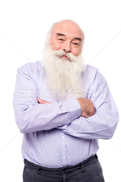 Hoary old man with crossed arms over white Stock photo © stockyimages