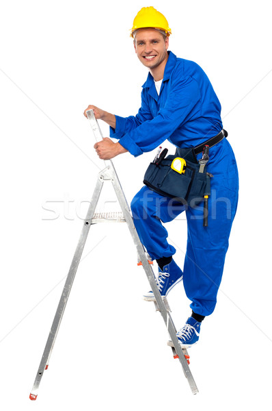 Repairman climbing up a stepladder Stock photo © stockyimages