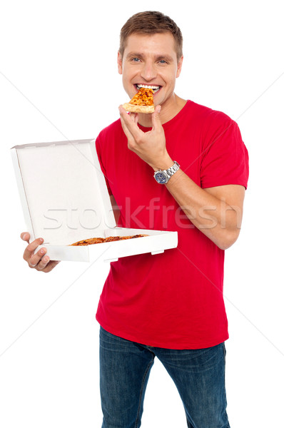 Cool young guy enjoying pizza Stock photo © stockyimages