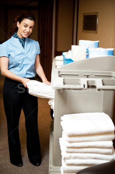 Housekeeping in charge pulling out the bath towel Stock photo © stockyimages