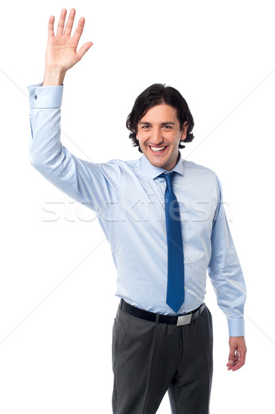 Businessman waving hi to his colleague Stock photo © stockyimages