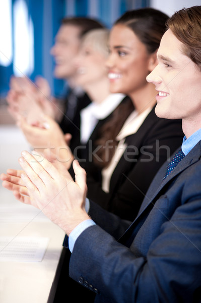 Team of four corporates applauding Stock photo © stockyimages