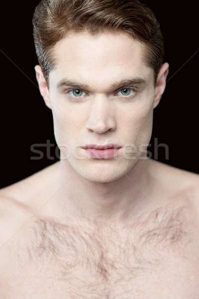 Young man with a bare-chested Stock photo © stockyimages