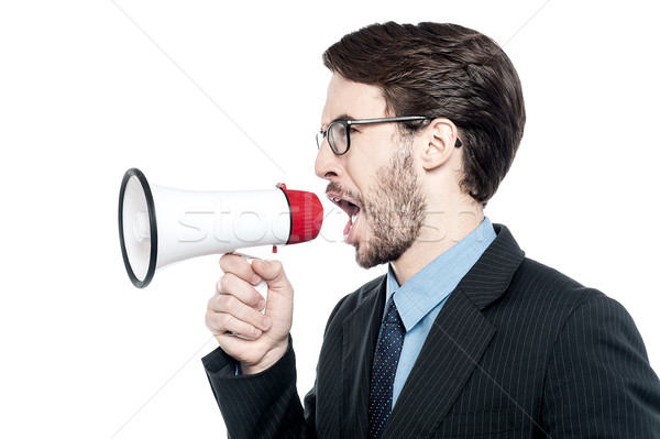 Man screaming with anger over loudhailer Stock photo © stockyimages