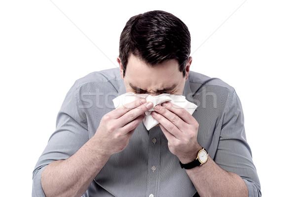 Hideg egészségtelen férfi orrot fúj beteg izolált Stock fotó © stockyimages