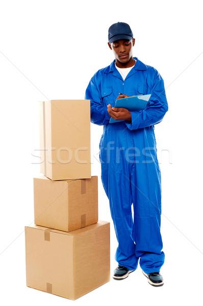 Entrega menino trabalhar amavelmente bens Foto stock © stockyimages