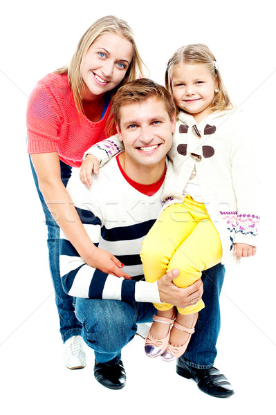 Portrait heureux parents fille regarder caméra Photo stock © stockyimages