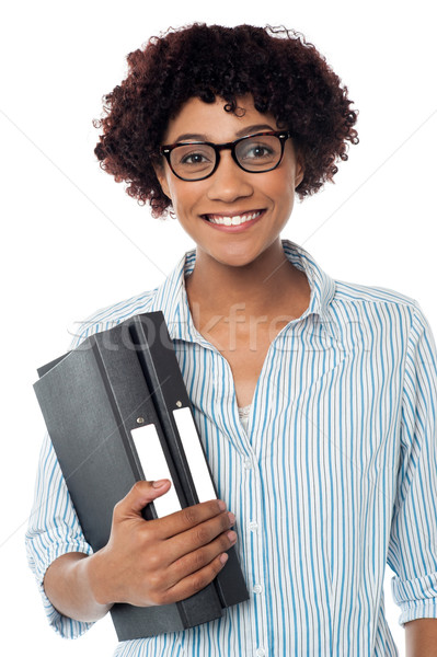 Bespectacled woman in casuals holding files Stock photo © stockyimages