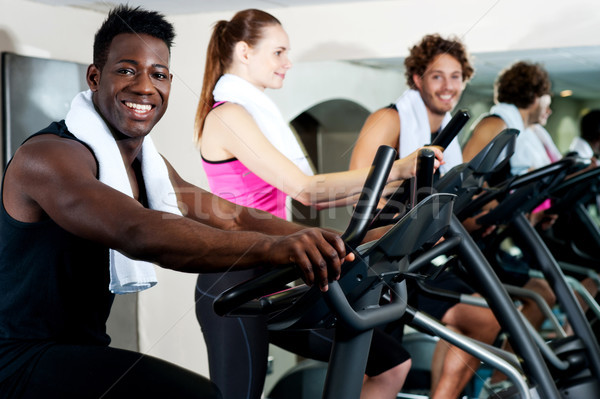 Gym trainer exercising along with his trainees Stock photo © stockyimages
