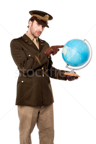 Stock photo: Military officer pointing something on globe