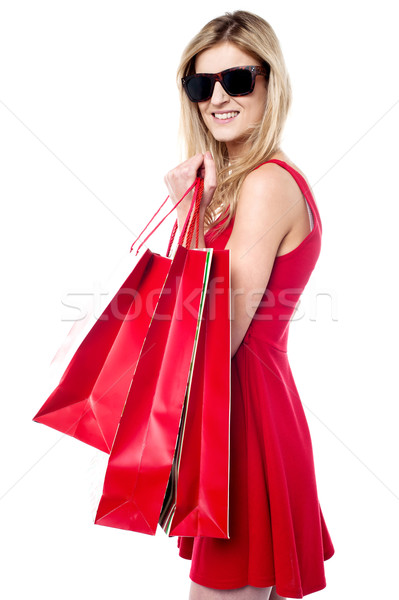 Trendy young shopaholic girl Stock photo © stockyimages