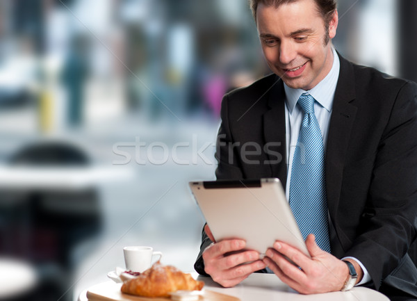 Handsome manager reviewing business updates Stock photo © stockyimages