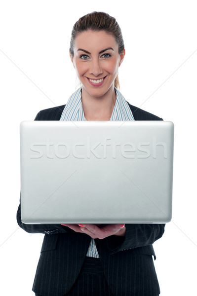 Smiling corporate lady holding brand new laptop Stock photo © stockyimages