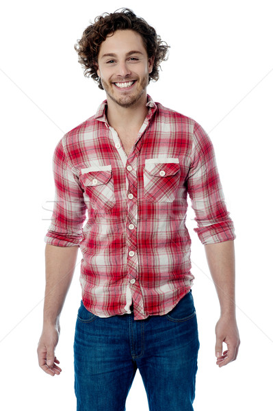 Smiling young casual man posing Stock photo © stockyimages