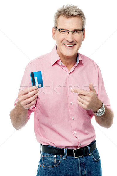 Senior man showing and pointing debit card Stock photo © stockyimages