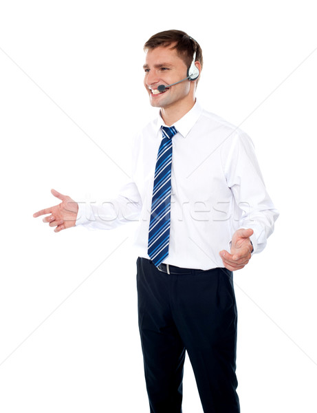 Smiling male operator explaining discounted offer Stock photo © stockyimages
