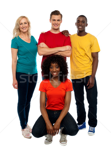 College mates posing against white background Stock photo © stockyimages