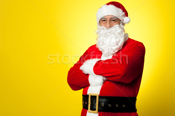 Saint Nick posing confidently against yellow background Stock photo © stockyimages