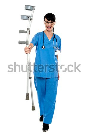 Stock photo: Smart looking female doctor, arms folded