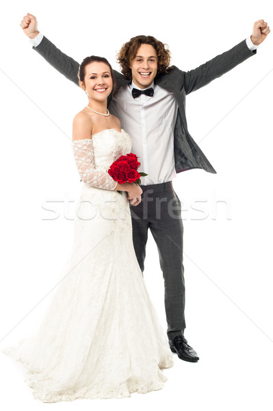 Joyous newlywed couple, excited guy Stock photo © stockyimages