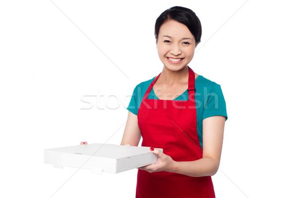 Female chef holding white pizza box Stock photo © stockyimages