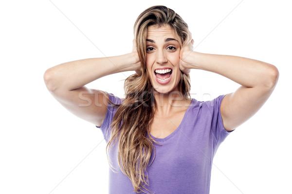Kifejező nő fülek fiatal nő kezek lány Stock fotó © stockyimages