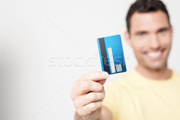 ハンサムな男 デビットカード 笑みを浮かべて 男 ストックフォト © stockyimages