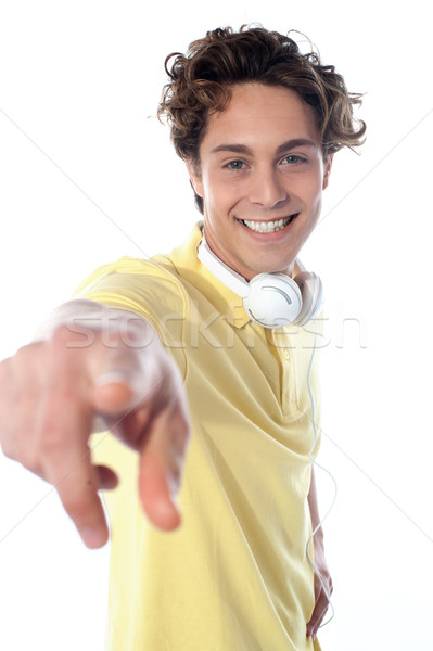 Guy with headphones pointing at you Stock photo © stockyimages
