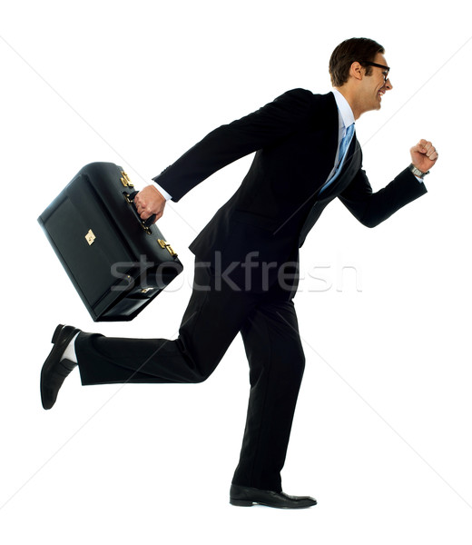 Professional man in running a posture Stock photo © stockyimages