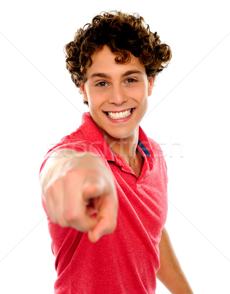 Handsome curly hair teen pointing at you Stock photo © stockyimages