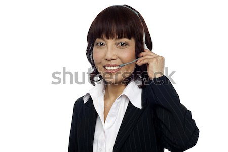 Cheerful asian customer support operator Stock photo © stockyimages