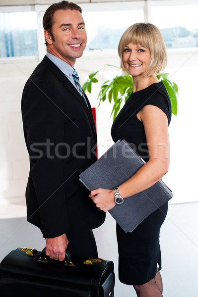 Businessman leaving office to attend meeting Stock photo © stockyimages