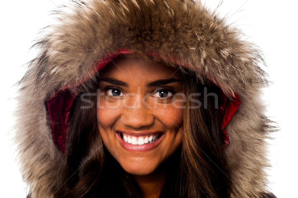 Pretty African girl in fur hood Stock photo © stockyimages