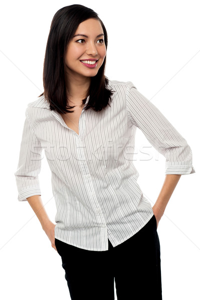 Casual businesswoman looking away Stock photo © stockyimages