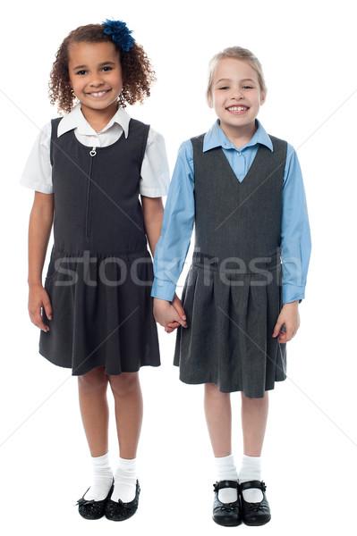 улыбаясь девочек школьную форму школы позируют Сток-фото © stockyimages