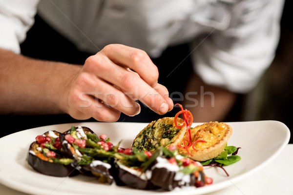 Chef decorating appetizer Stock photo © stockyimages