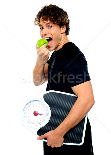 Smart boy eating green apple Stock photo © stockyimages