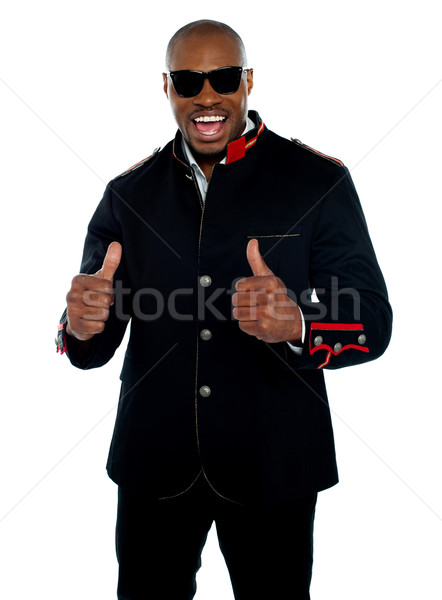 Handsome excited african with double thumbs-up Stock photo © stockyimages