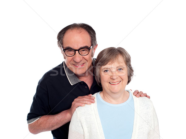 Lovable husband posing along with wife Stock photo © stockyimages