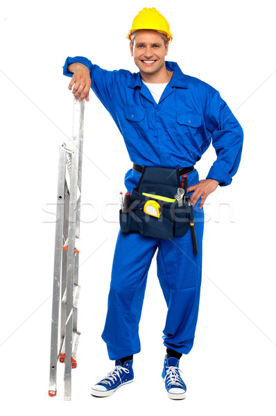 Industrial contractor resting hand on stepladder Stock photo © stockyimages