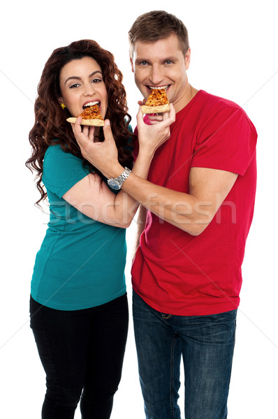 Adorable love couple enjoying pizza pie together Stock photo © stockyimages