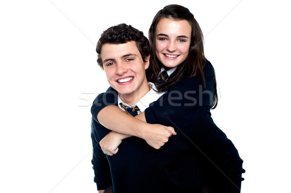Young girl on her friends back, enjoying piggy ride Stock photo © stockyimages