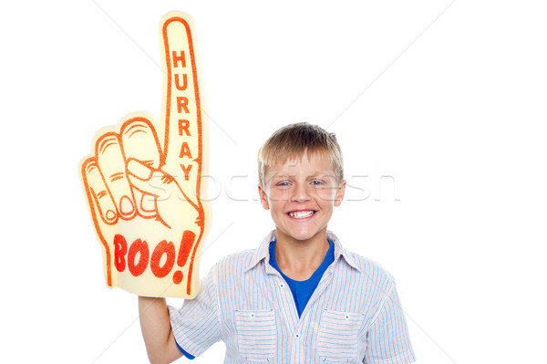 Boy with a hurray boo foam hand. Young fan Stock photo © stockyimages