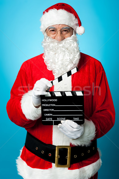 Bespectacled Santa holding a clapperboard Stock photo © stockyimages