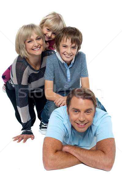Fun loving family exhibiting great bonding Stock photo © stockyimages